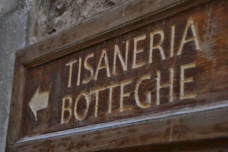 Text Architecture No People City Close-up Day Outdoors Tisaneria Bottega Abruzzo Italy Travel Destinations Sign Sign Board Wodden Wodden Texture Modern Workplace Culture