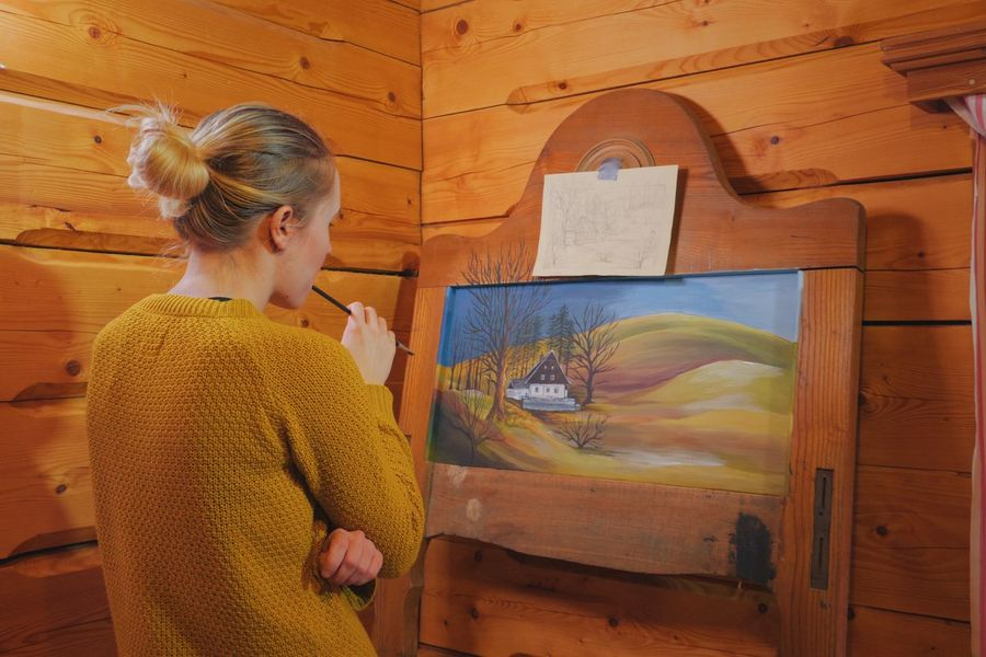 woman painter painting a picture on a reclaimed wooden board inside cozy wooden cottage Landscape Art Artist ArtWork At Home Brush Cabin Cottage Creative Creativity DIY Hand Handmade Illustration Indoors  Painter Painting Precision Reclaimed Romantic Rustic Woman Wood Work Working