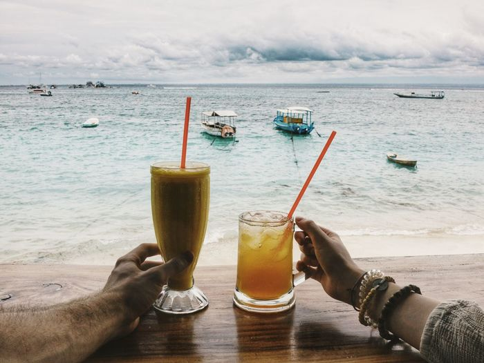 Drinks Drinking Beverage Beach Sea Ice Tea Mango Smoothie Hands From My Point Of View Vacation Holiday Summer Bali INDONESIA Red Straws Boats Beach Bar Liquid Lunch People Together My Year My View Live For The Story Sommergefühle Be. Ready. An Eye For Travel