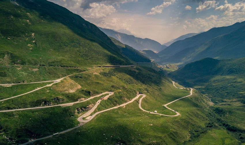 Mountain Nature Winding Road Road Curve Scenics Landscape Beauty In Nature Tranquility Outdoors Mountain Range High Angle View Tranquil Scene Transportation Mountain Road No People Day Grass Sunset Sky