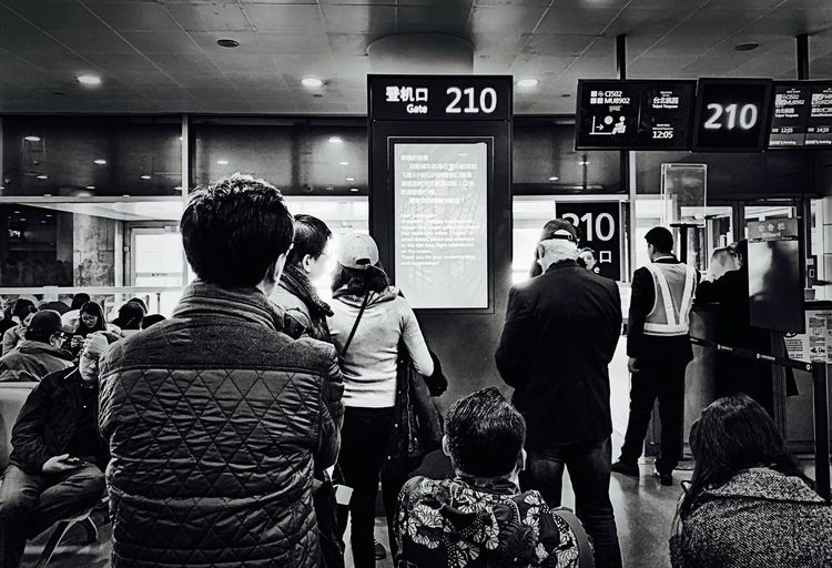 Airport Communication Real People Indoors  Rear View Text Group Of People Lifestyles People Business Men Women Information Choice Adult Crowd Shopping Retail  Western Script Number Technology