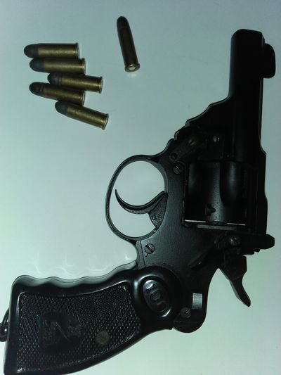 revolver Revolver Gun Ammunition Weapons Of War Weapon Indian Ordinance Bullets With Gun Bullet Gun Bullet Revolver Rewolver .22 .22 Caliber Indoors  No People Violence Art And Craft Handgun Gun Single Object Security Business Finance And Industry Metal Aggression