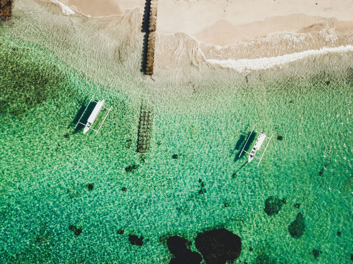 Beachfront Boats Clear Water Close-up Coral Day Green Color High Angle View Land Nature No People Non-urban Scene Outdoors Plant Reef Sand Sandy Beach Scenics - Nature Sunlight Transparent Turquoise Colored Water Waves Waves, Ocean, Nature
