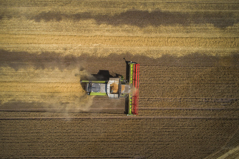 Directly Above Shot Of Combine Harvester On Farm