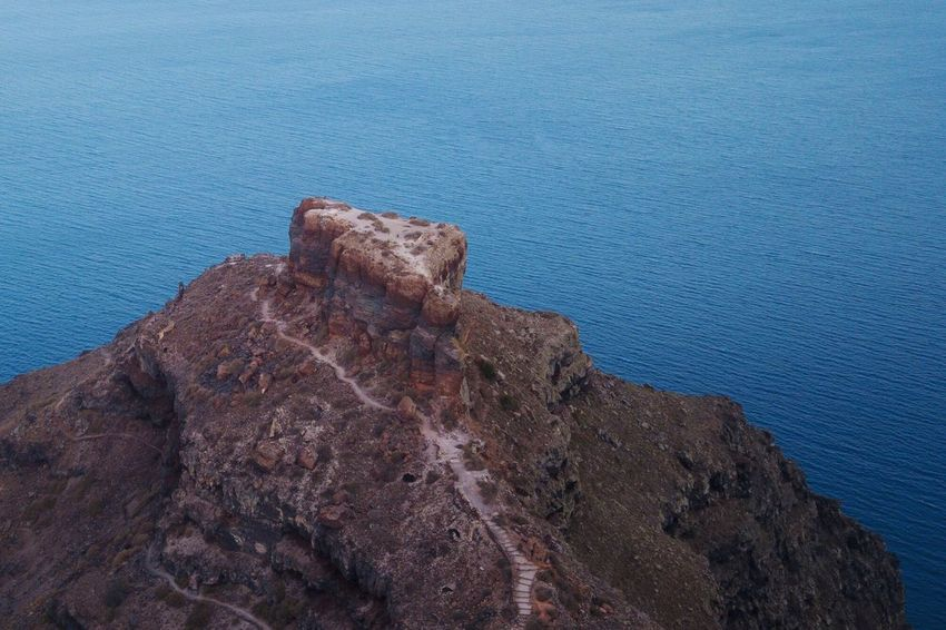 Skaros Rock, Santorini Blue Rock Nature Beauty In Nature Rock - Object Solid Water Day High Angle View Sea Tranquility Textured  Rock Formation No People Rough Outdoors