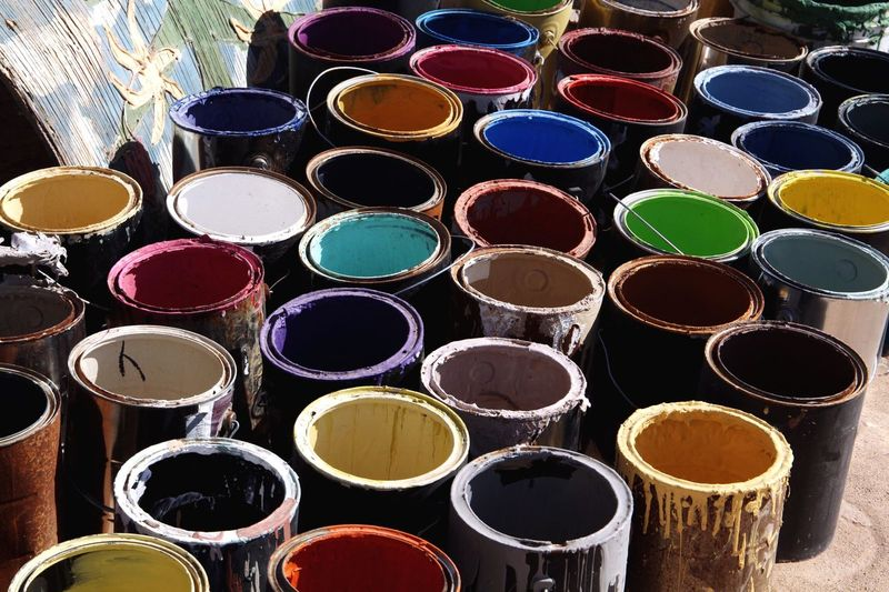 Years of color. These paint buckets are just a handful used to paint Salvation Mountain in the California desert. | @LostBoyMemoirs Art Colorful California Salvation Mountain Color Paint Arrangement No People Geometric Shape Circle Stack Large Group Of Objects Shape Industry Multi Colored Repetition Backgrounds Still Life