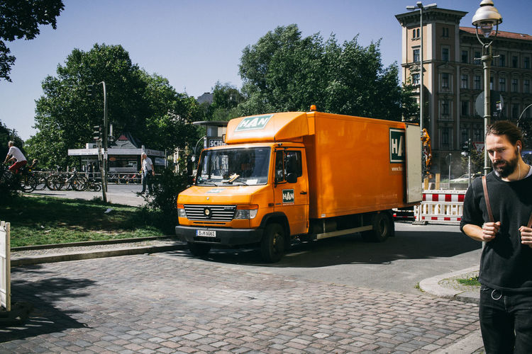 24mm Architecture Berlin City Life City Street Day Men Orange Pedestrian People Street Photography Streetphotography Truck Urban VSCO Walking