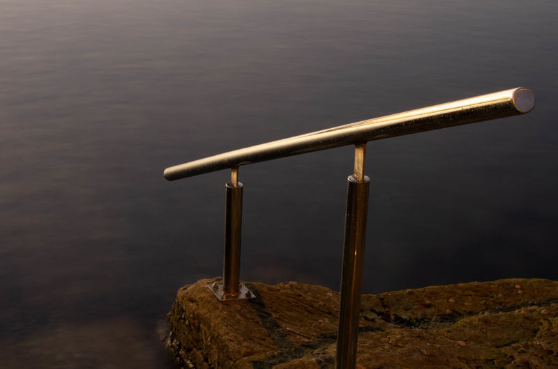 Astronomy Close-up Day Focus On Foreground Hand-held Telescope High Angle View Lake Metal Nature No People Outdoors Railing Rock Rock - Object Security Silver Colored Solid Tranquility Water Wood - Material