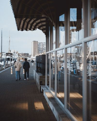 Keep walking Vintage Reflection Light And Shadow Mood Hafen Dock Built Structure Architecture Rear View Building Exterior Standing City Lifestyles Outdoors People Sky EyeEmNewHere