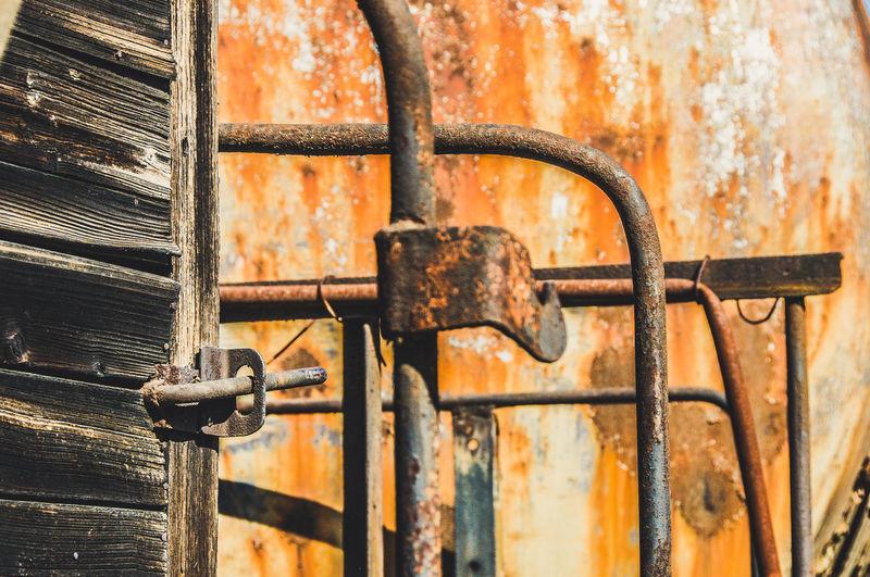 Close-up of rusty metal gate
