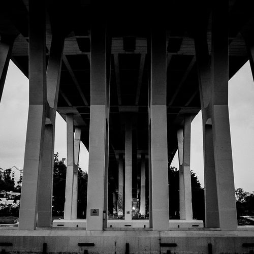 The Benjamin Sheares Flyover, Singapore Arch Architectural Column Architectural Feature Architecture Below The Bridge Bridge Support Built Structure Capital Cities  City City Life Column Day Engineering Historic History Low Angle View Modern No People Sky SUPPORT Tourism Travel Destinations The Architect - 2018 EyeEm Awards