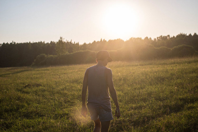 Beauty In Nature Day EyeEmNewHere Field Grass Landscape Men Nature Nature One Man Only One Person People Rear View Sky Sun Sunlight Sunlight Sunset Travel Traveling Tree Walking Around Young Men