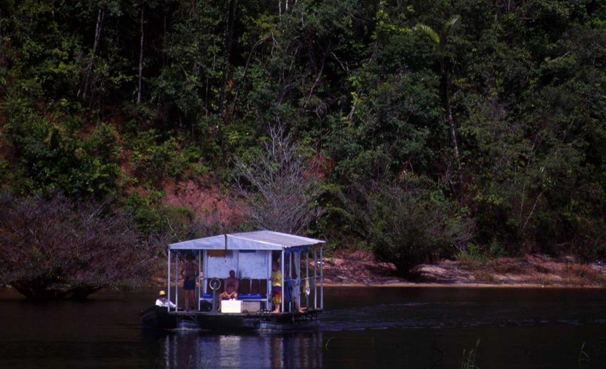 Men on boat over lake