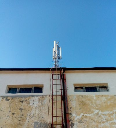 Transformer Building Architecture Building Building Exterior Cellphone Tower Clear Sky Outdoors Robot Tower Minimalist Architecture