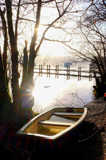 Beautiful Nature Rowing Boat Bare Tree Beauty In Nature Boat Branch Cold Temperature Day Jetty Jetty Structure Jetty, Pier Lake Windermere Lens Flare Misty Morning Nature No People Outdoors Snow Sun Sunlight Tranquil Scene Tranquility Tree Windermere Winter