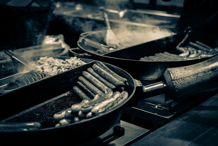 Food cooking in pans on stove