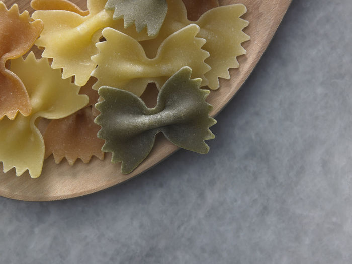 Close-up of farfalle pasta in plate on table
