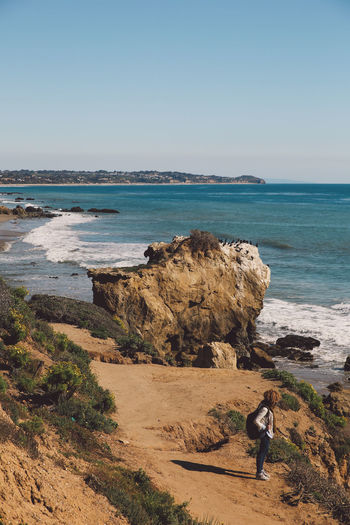 California El Matador Beach Pacific Adult Beach Beauty In Nature Clear Sky Curly Hair Day Full Length Girl Horizon Over Water Leisure Activity Nature Ocean One Person One Woman Only Outdoors People Real People Rock - Object Sand Scenics Sea Shore Sky Standing Water Women