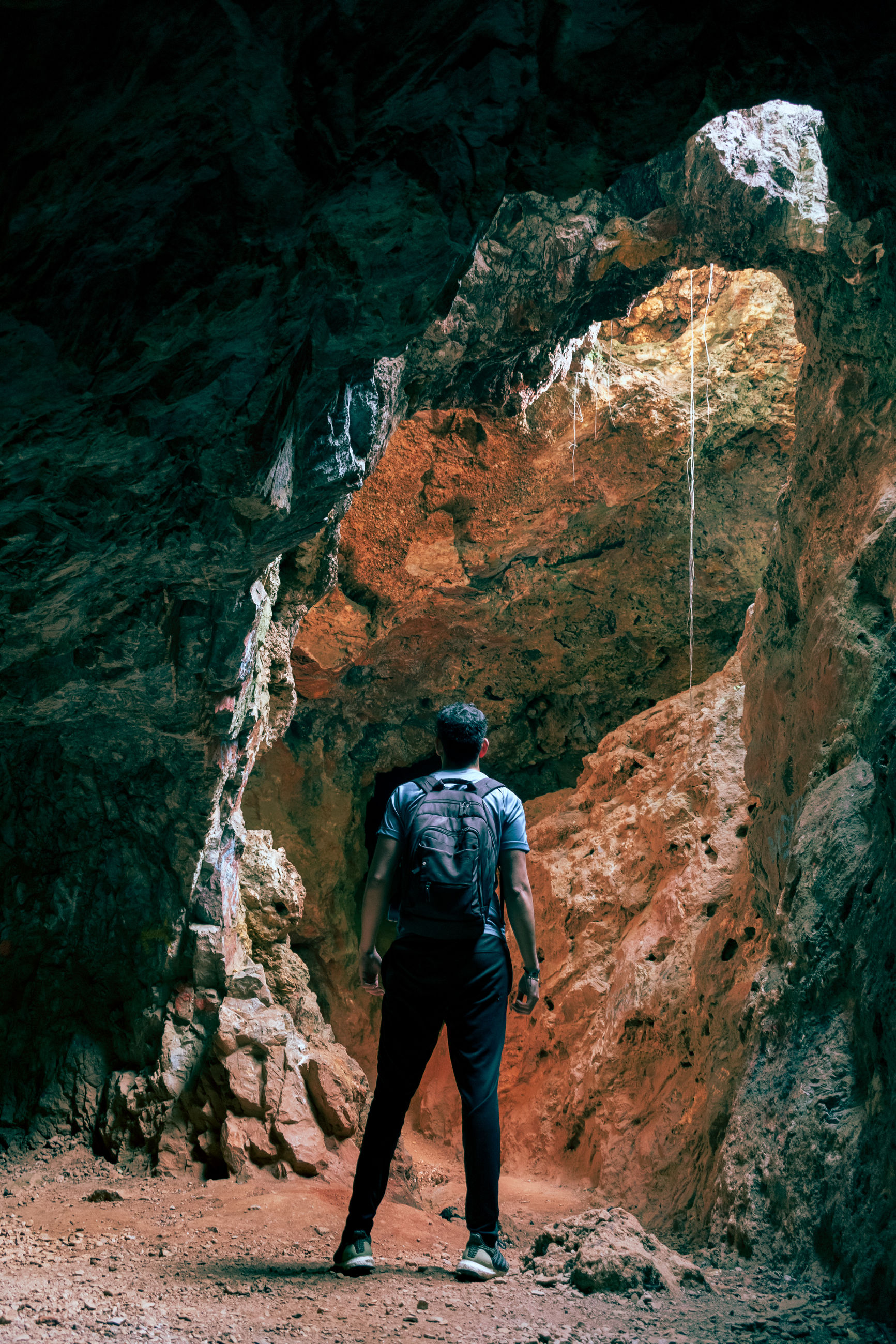 leisure activity, rear view, one person, full length, real people, adventure, rock, hiking, lifestyles, activity, backpack, rock - object, mountain, nature, standing, men, solid, rock formation, travel, outdoors, formation