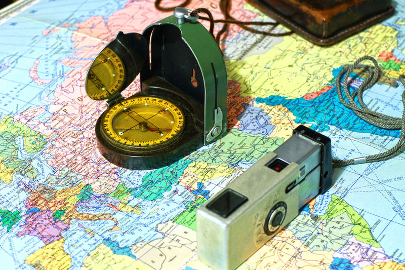 Compass and spy camera on Russian map Analog Arrow Camera Compass Creativity Direction Europe Exploration Low Tech Map Mirror Orientation Pointing Russian Spy Vibrant Color