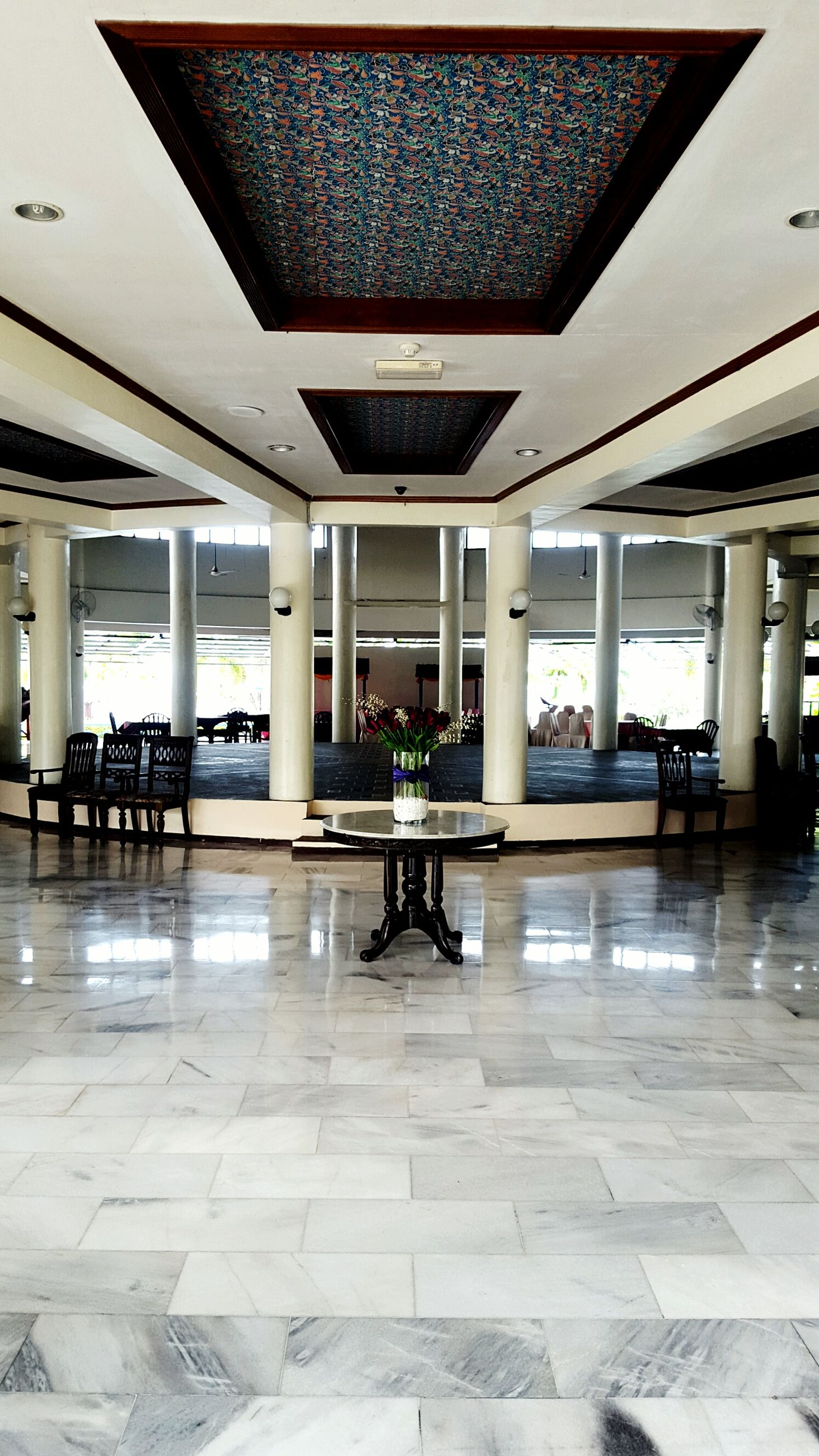 indoors, built structure, architecture, architectural column, flooring, ceiling, tiled floor, column, chair, person, incidental people, men, sunlight, restaurant, table, day, empty, travel, sitting