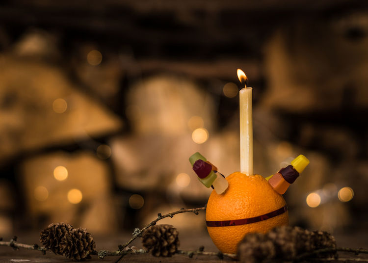 Christmas Candle Christingle Candle Flame Burning Indoors  Celebration Illuminated Fire Heat - Temperature Food And Drink Food No People Decoration Holiday Close-up Fire - Natural Phenomenon Christmas Focus On Foreground Glowing Table Selective Focus Christmas Ornament Dark Advent