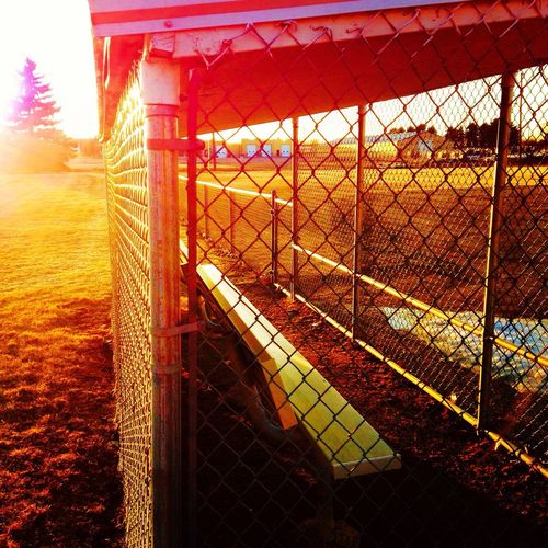 Dugout at Dusk Sunset Built Structure Railing Architecture Metal Outdoors Beauty In Nature Sunlight Fieldscape No People EyeEmNewHere EyeEmNewHere EyeEmNewHere