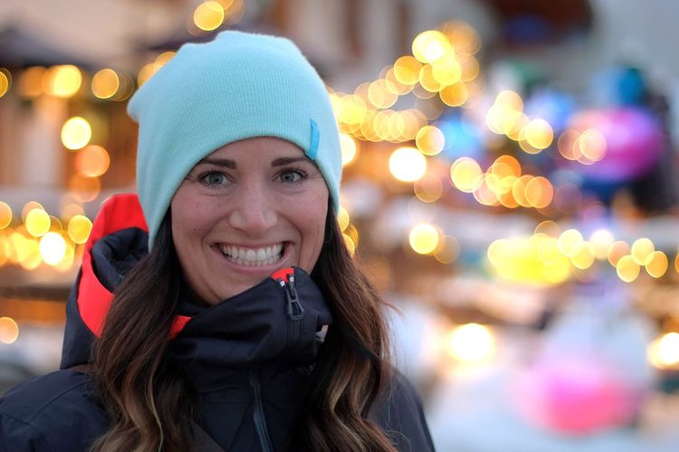 Portrait of smiling young woman in park during winter