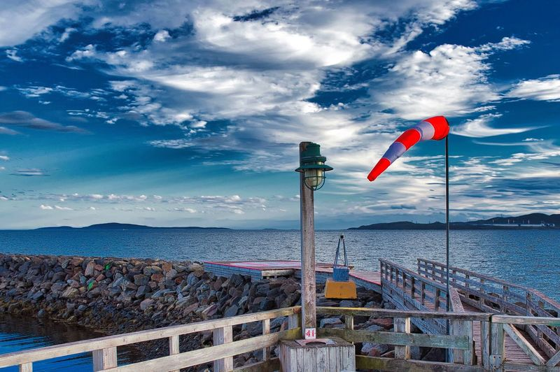 Water Sky Cloud - Sky Flag Sea Patriotism Nature Beauty In Nature Day Scenics - Nature No People Tranquility Tranquil Scene Architecture Beach Built Structure Horizon Over Water Non-urban Scene Outdoors National Icon Helipad