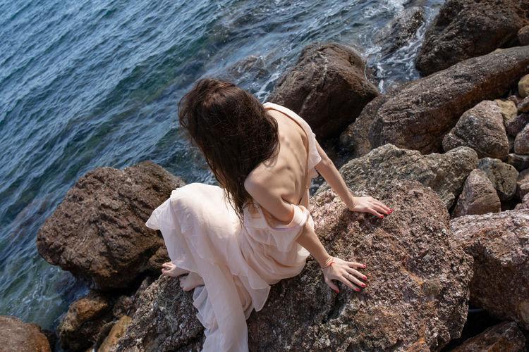 High angle view of woman looking at sea