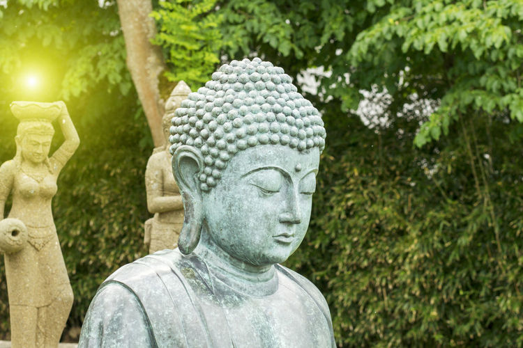 Buddha statue with enlightenment Buddha Buddha Statues Meditation Art And Craft Creativity Human Representation Meditation Garden Meditation Zen Outdoors Religion Sculpture Spirituality Statue