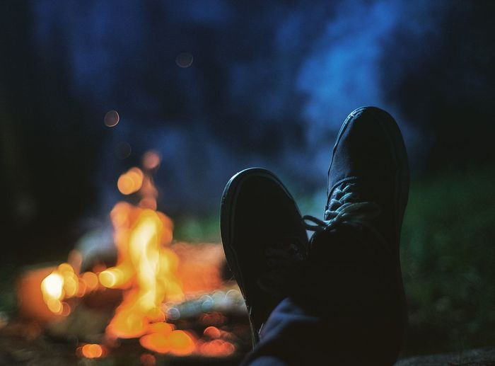 Low section of man against bonfire at night