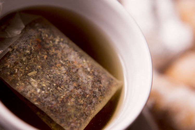 Close-up of teabag in cup