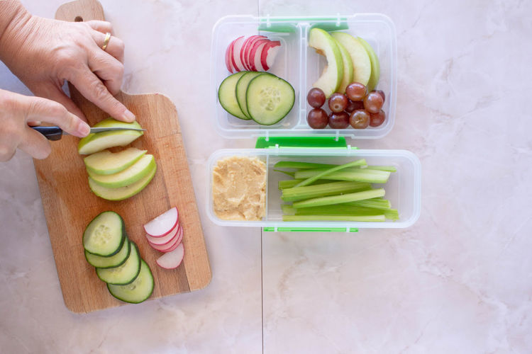 Meal Apple - Fruit Food Food And Drink Freshness Fruit Healthy Eating Healthy Lifestyle High Angle View Human Body Part Human Hand Meal Planning Meal Prep Meal Preparation Preparation  Preparing Food SLICE Snack Vegetable Wellbeing