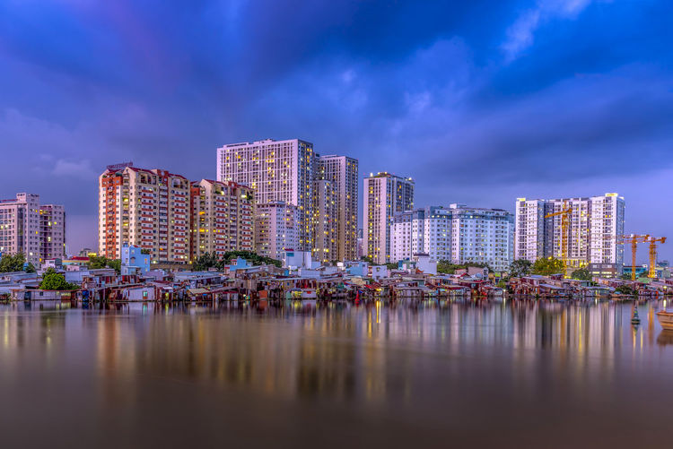 Blue hour in Saigon city, Vietnam. Architecture Building Exterior Building Water City Built Structure Office Building Exterior Reflection Sky Residential District Skyscraper Landscape Waterfront Nature Travel Destinations Cityscape Urban Skyline Office Night No People Modern Outdoors Apartment