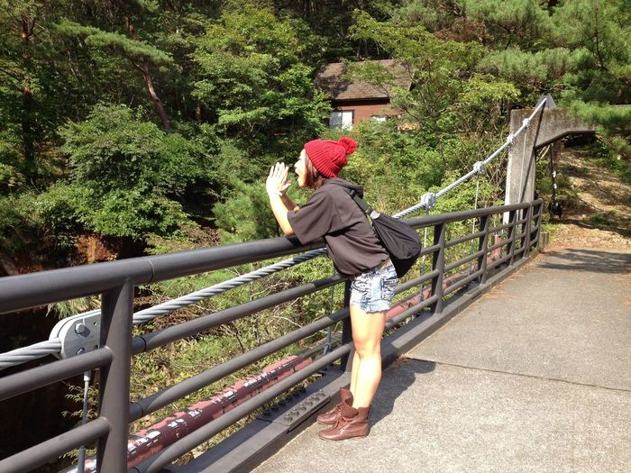 A Girl In The Nature Outdoors Adventure Beenie Mountains On The Bridge