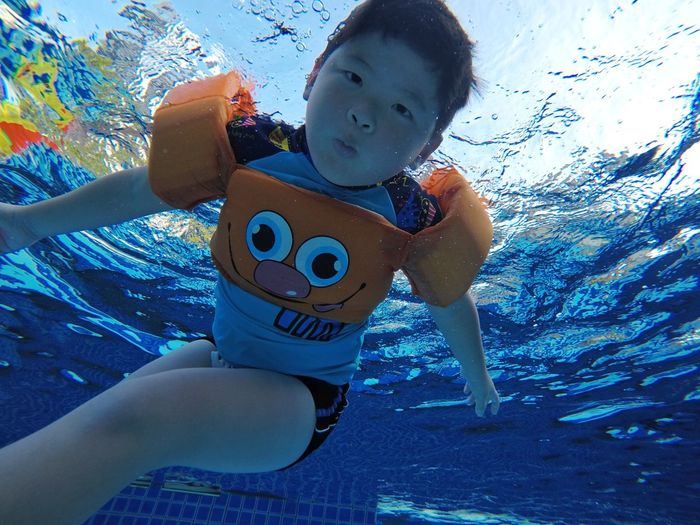 Cute boy swimming in pool