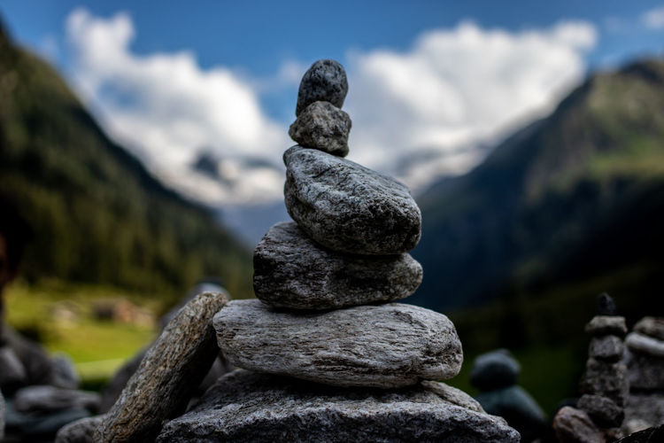 Balance Stack Stone - Object Nature Zen-like No People Solid Rock Focus On Foreground Cloud - Sky Tranquility Mountain Rock - Object Tranquil Scene Day Sky Beauty In Nature Stone Close-up Pebble Outdoors EyeEmNewHere