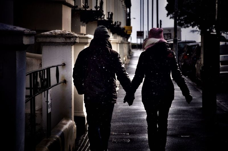 ~SnowFall~ A Lovers Pace Streetstyle Streetphotography Winter Warm Clothing Weather Walking Rear View Street Silhouette Cold Temperature Togetherness Lifestyles Outdoors Snow City Visual Creativity Adventures In The City Human Connection Moments Of Happiness