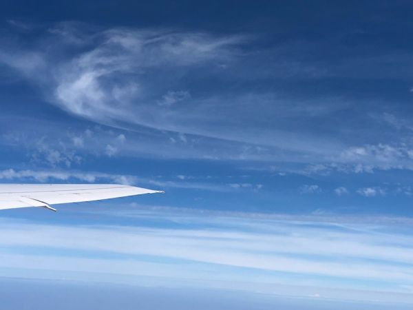 Cloud - Sky Sky Scenics - Nature Beauty In Nature Tranquil Scene Tranquility Blue Nature No People Day Environment Airplane Mode Of Transportation Meteorology Low Angle View Idyllic Transportation Air Vehicle Outdoors Cloudscape