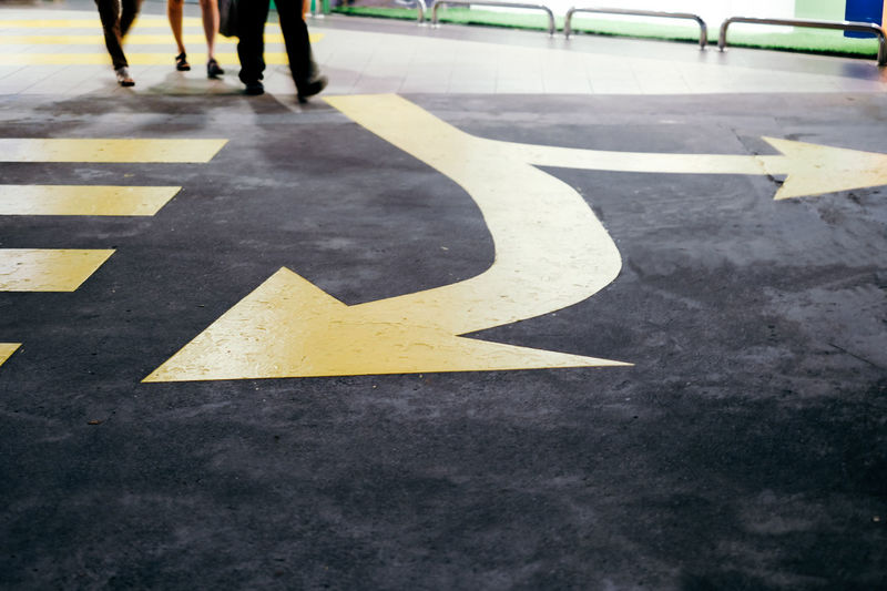 Low section view of arrow symbol on road