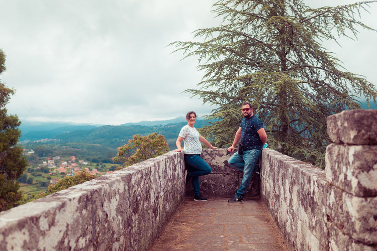 Portrait of couple standing at observation point