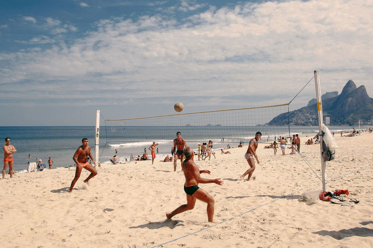 An old photo of men playing foot volleyball in Ipanema Beach, Rio de Janeiro, Brazil. Beach Life Brasil ♥ Brasilien Ipanema Beach Lifestyle Adult Beach Beach Day Beach Volleyball Brasil Day Enjoyment Ipanema Leisure Activity Lifestyles Outdoors People Playing Real People Sand Sea Shirtless Sport Summer Volleyball - Sport