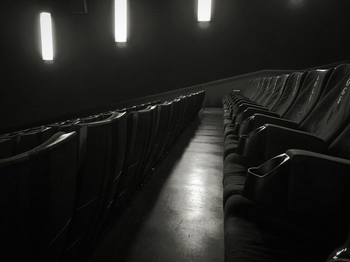 Indoors  No People Illuminated Auditorium Cinema Seating Cinema Seats Waiting For The Movie Kinosessel Kinosaal Kino Blackandwhite Black And White Black & White White Black Cinema Indoors  Blackandwhite Photography Black And White Collection