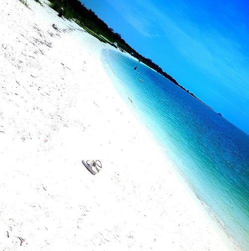 Feel The JourneyFort Myers Beach White Sand Beach Ocean Tranquility Flipflops Sky And Clouds Beachphotography Beach Beach Life Florida My First Photo On EyeEm  My Own Photography Relaxing Enjoying Life Eyemphotography EyeEmBestPics Travel Gettyimagesgallery Photo By Me The Portraitist - 2016 EyeEm Awards USA Hello World Calm Sunny