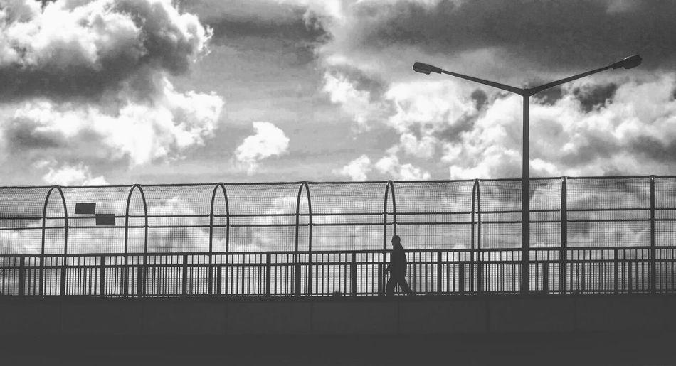 Man On Elevated Walkway