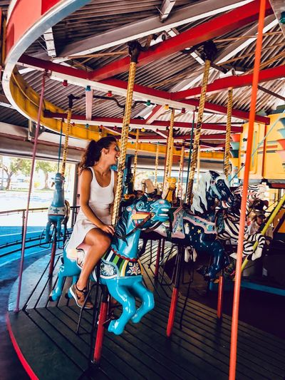 Woman sitting in amusement park ride