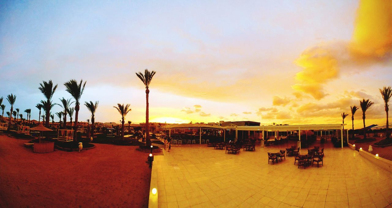 PANORAMIC VIEW OF PEOPLE AT SUNSET