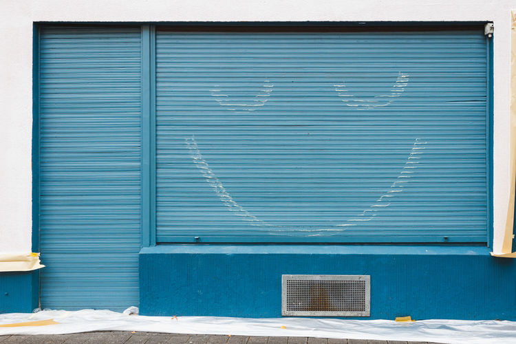 Smiling Roller Blind City Life Fun Architecture Blue Building City Closed No People Painter Positive Emotion Shutter Smile Smiling Smiling Face Smily Wall - Building Feature