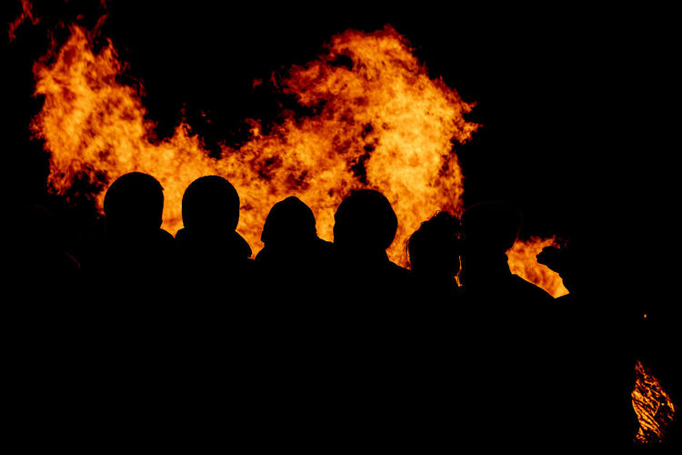 Silhouette of bonfire at night